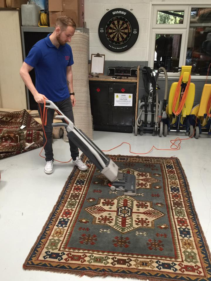 Vacuuming rug - Cheshire Rug Cleaning